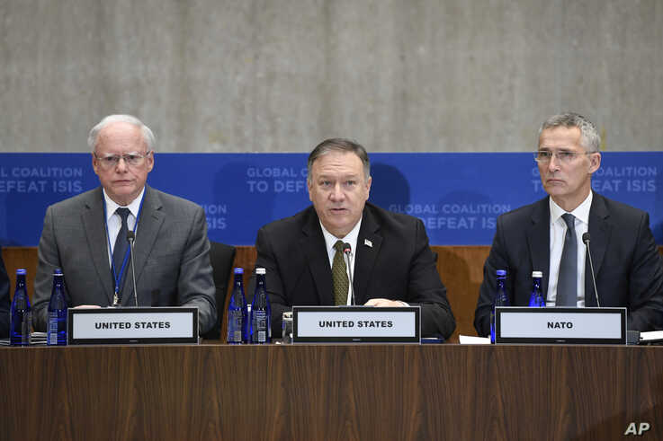 Secretary of State Mike Pompeo, center, flanked by James Jeffrey, the State Department's Special Representative on Syria, left,…