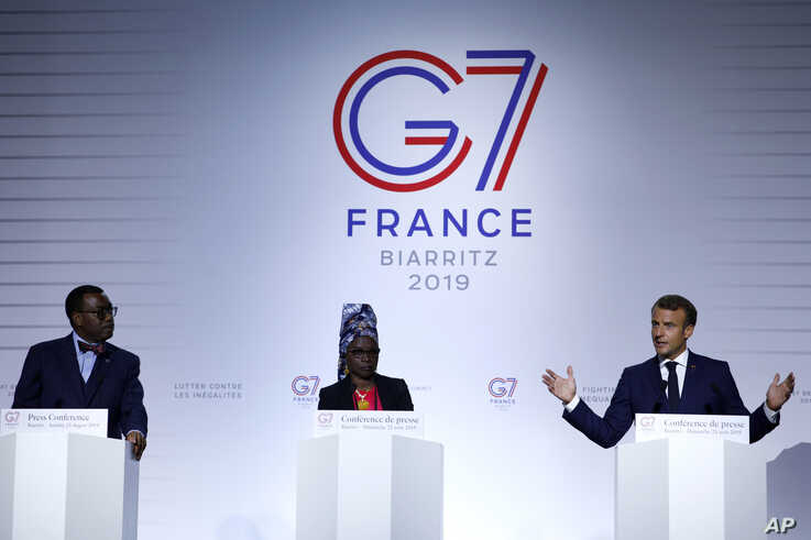FILE - In this Sunday Aug. 25, 2019 file photo French President Emmanuel Macron, right, African Development Bank President…