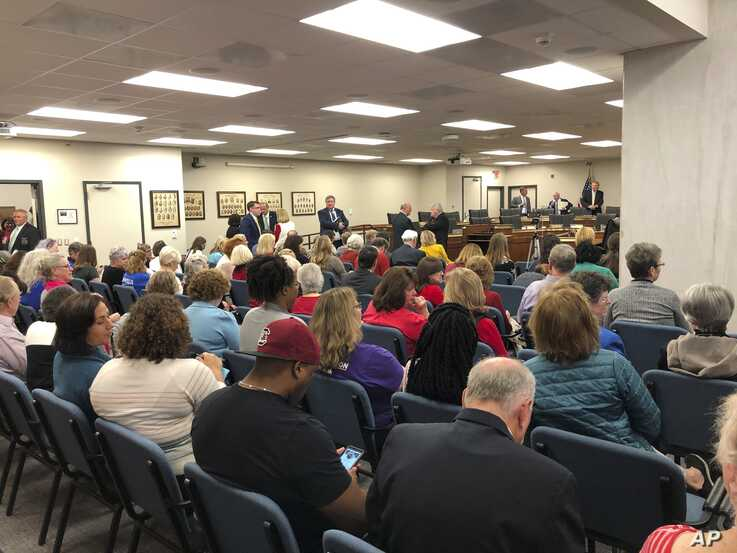 """A crowd fills a South Carolina Senate hearing room as a Senate committee considers a strict """"heartbeat abortion"""" ban on Tuesday…"""