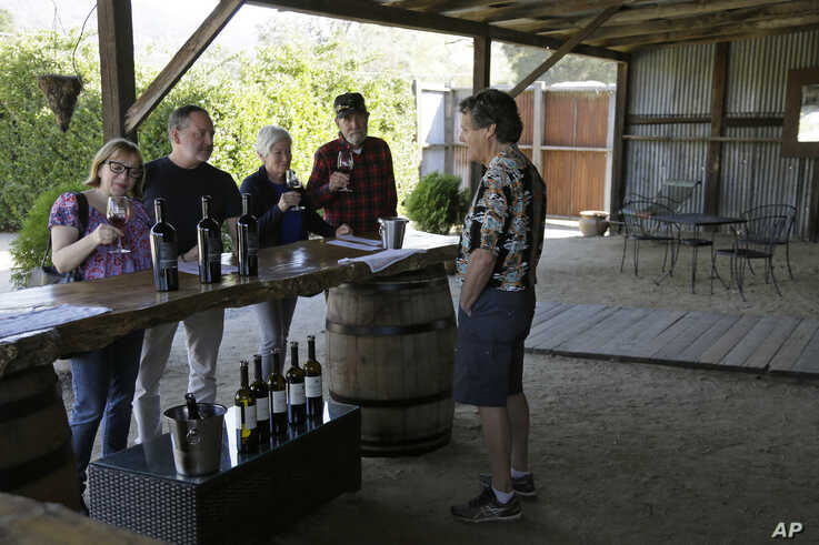 In this Wednesday, Nov. 6, 2019 photo, Mark Dankowski, right, leads a tasting for a group of people visiting the Soda Rock…
