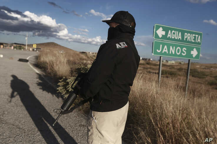 Chihuahua state police officers man a checkpoint in Janos, Chihuahua state, northern Mexico, Tuesday, Nov. 5, 2019. Drug cartel…