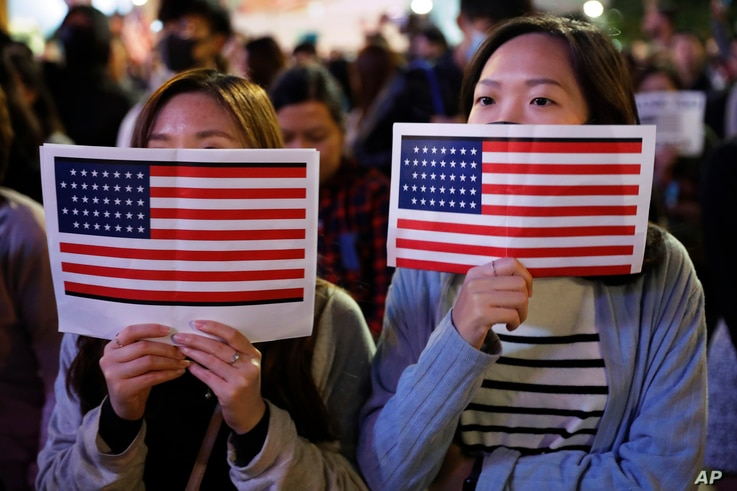 Protester holds U.S. flags during a demonstration in Hong Kong