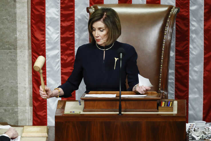 House Speaker Nancy Pelosi of Calif., strikes the gavel after announcing the passage of article II of impeachment against…