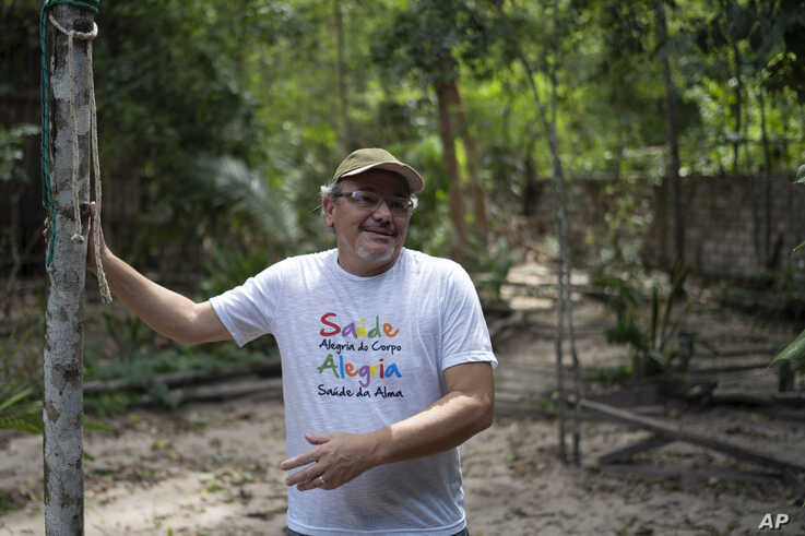"""In this Dec. 1, 2019 photo, Caetano Scannavino, coordinator of NGO """"Saude e Alegria,"""" or Health and Happiness, gives an…"""