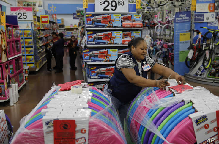 Balo Balogun labels items in preparation for a holiday sale at a Walmart Supercenter, Wednesday, Nov. 27, 2019, in Las Vegas…