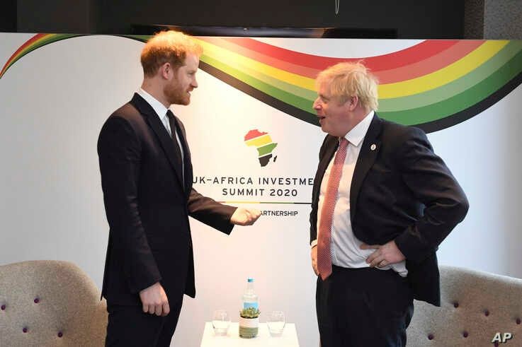 Britain's Prince Harry and Prime Minister Boris Johnson, right, at the UK Africa Investment Summit in London, Monday Jan. 20,…
