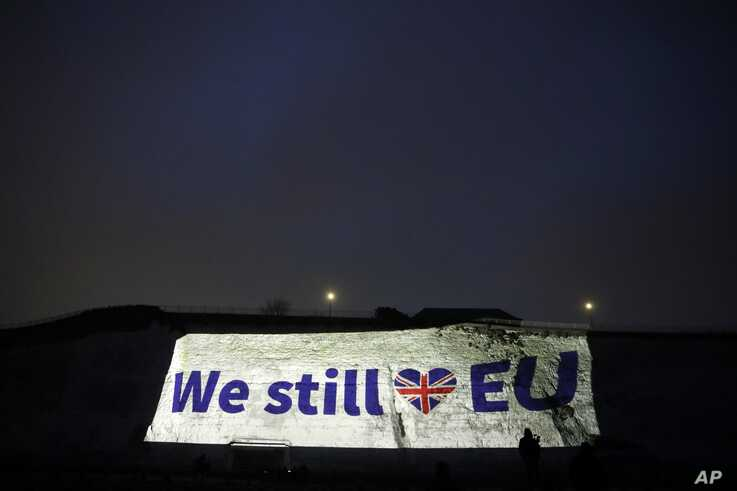 A projection appears on a wall in Ramsgate, southern England, Friday, Jan. 31, 2020. Britain officially leaves the European…