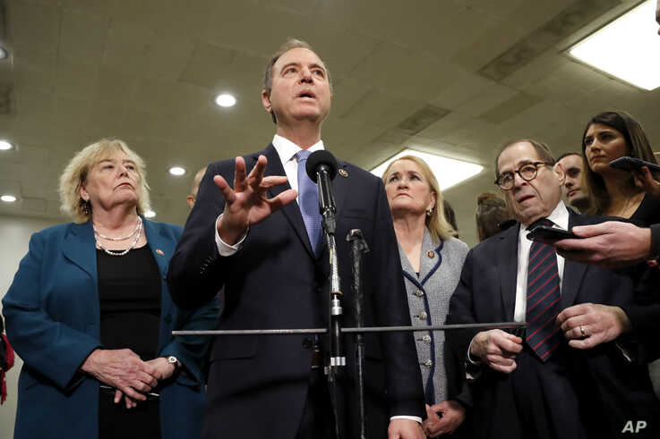 House impeachment manager Rep. Adam Schiff, D-Calif., second from left, speaks to reporters while standing with Rep. Zoe…