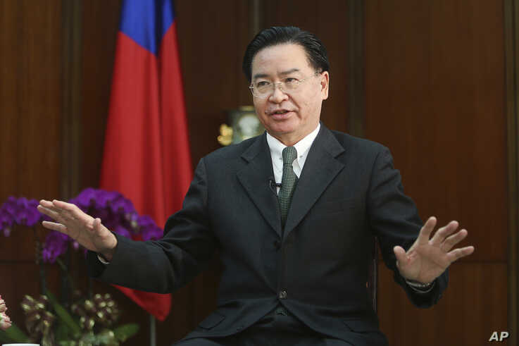 Taiwanese Foreign Minister Joseph Wu gestures while speaking during an exclusive interview with The Associated Press at his…
