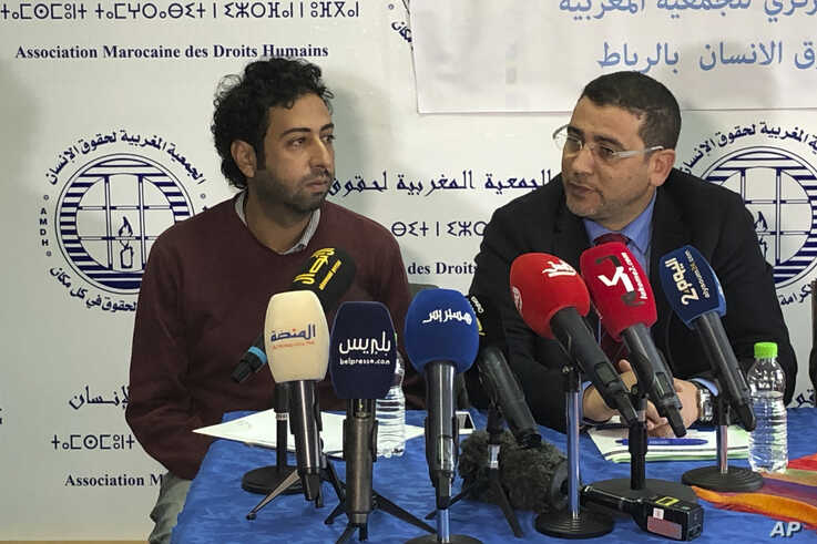 Omar Radi, left, and one of his lawyer Miloud Kandil attend a press conference at the Moroccan Association for Human Rights in…