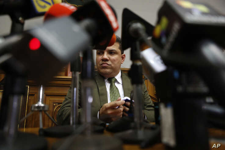 Lawmaker Luis Parra gives a press conference at the National Assembly in Caracas, Venezuela, Monday, Jan. 6, 2020. The previous…