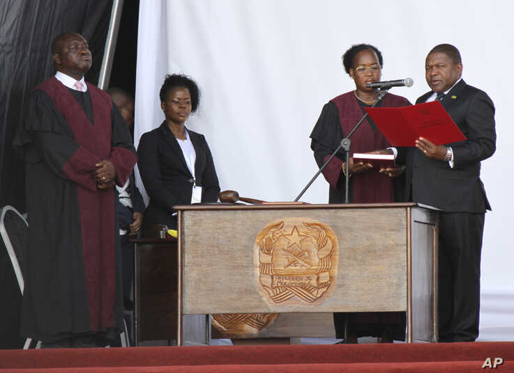 Mozambique's President Filipe Nyusi, right, during his inauguration ceremony in Maputo, Mozambique, Wednesday, Jan. 15, 2020…