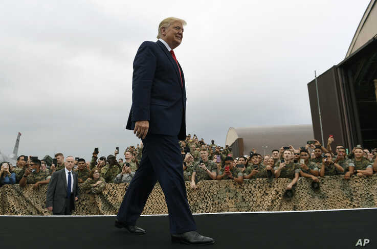 President Donald Trump arrives to speak to troops at Osan Air Base in South Korea, Sunday, June 30, 2019. (AP Photo/Susan Walsh)