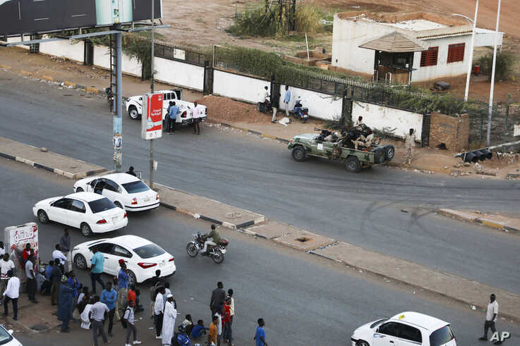Members of the Rapid Support Forces, a paramilitary force operated by the Sudanese government, block roads in Khartoum, Sudan,…