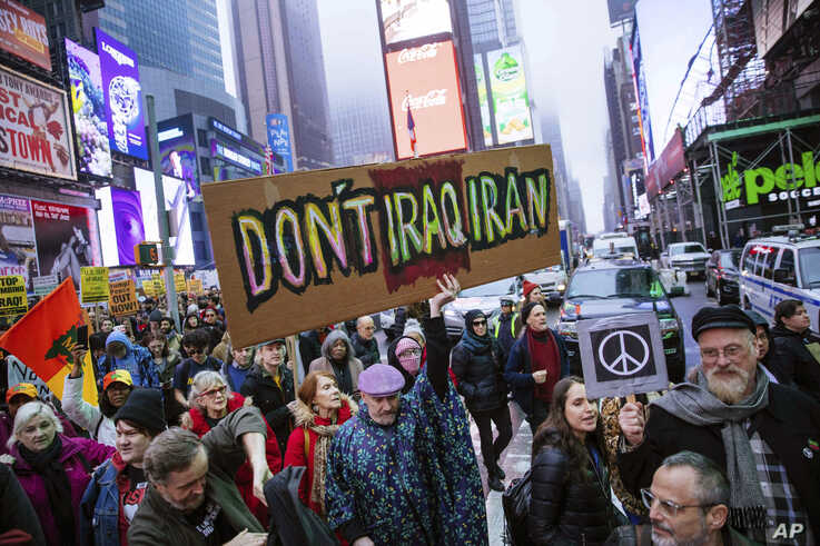 Activists march in Times Square to protest recent U.S. military actions in Iraq on Saturday, Jan. 4, 2020, in New York.  A top…