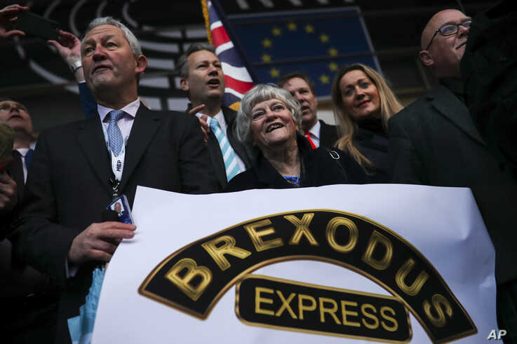 British MEP's, including Anne Widdecombe, center, celebrate as they march out of European Parliament with their luggage in…