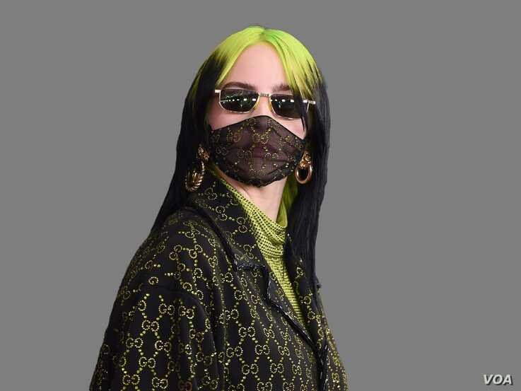 Billie Eilish, as singer songwriter, arrives at the 62nd annual Grammy Awards at the Staples Center, Los Angeles, graphic…
