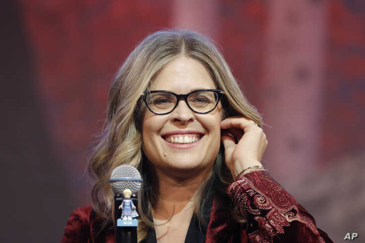 """Director Jennifer Lee smiles during a press conference for her new movie """"Frozen 2"""" in Seoul, South Korea, Monday, Nov. 25,…"""