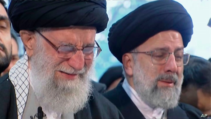 In this image taken from video, Iranian Supreme Leader Ayatollah Ali Khamenei, left, openly weeps as he leads a prayer over the…