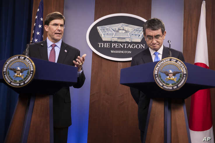 Defense Secretary Mark Esper and Japan's Defense Minister Taro Kono speak during a news conference at the Pentagon in…