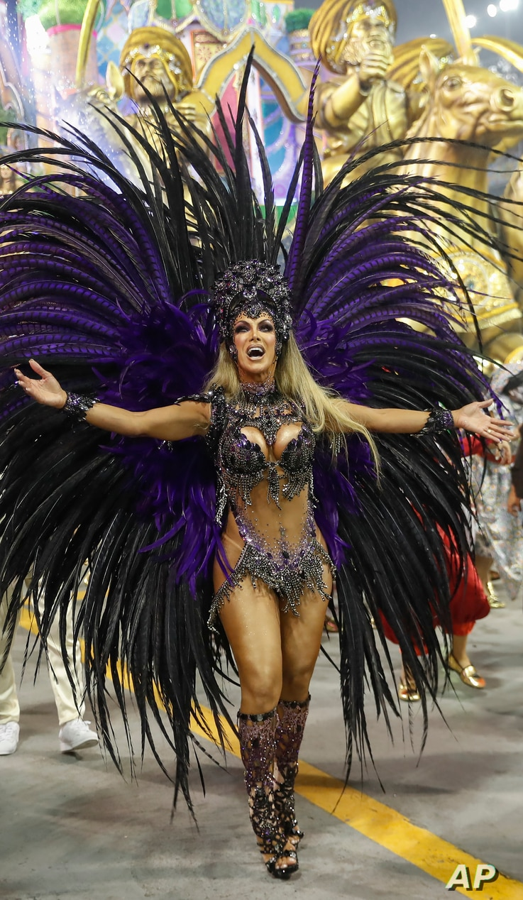 Transgender godmother Camila Prins from the Colorado do Bras samba school performs during a Carnival parade in Sao Paulo,…
