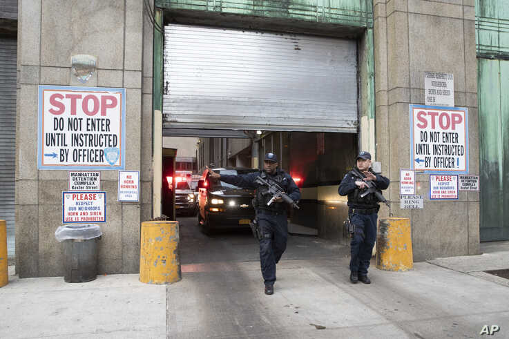 Armed corrections officers clear the sidewalk for an ambulance escorting Harvey Weinstein from a Manhattan courthouse, Monday,…