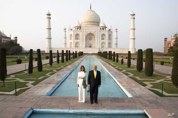 President Donald Trump, with first lady Melania Trump, pause as they tour the Taj Mahal, Monday, Feb. 24, 2020, in Agra, India…