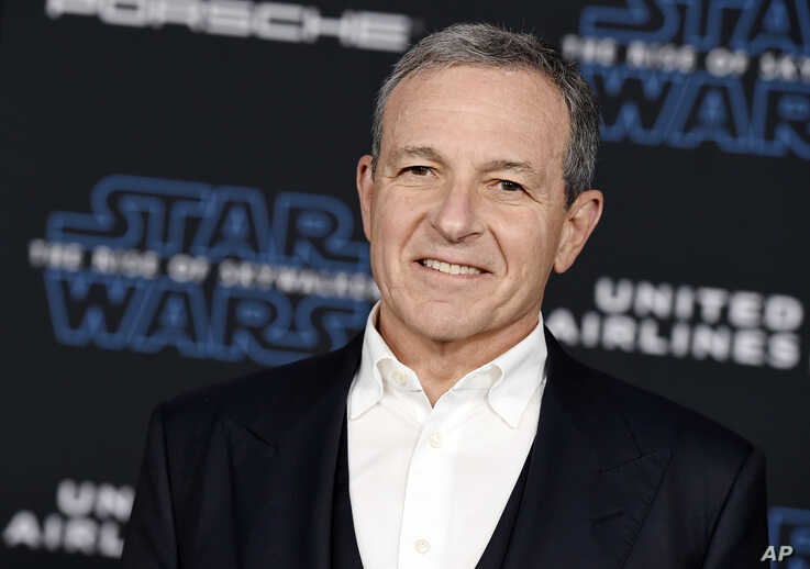 "FILE - In this Dec. 16, 2019, file photo, Disney CEO Robert Iger arrives at the world premiere of ""Star Wars: The Rise of…"