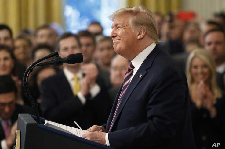 President Donald Trump pauses as he speaks in the East Room of the White House in Washington, Thursday, Feb. 6, 2020. (AP Photo…