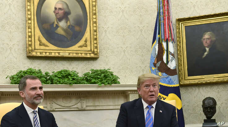 President Donald Trump, right, speaks while meeting with Spain's King Felipe VI, left, in the Oval Office of the White House in…