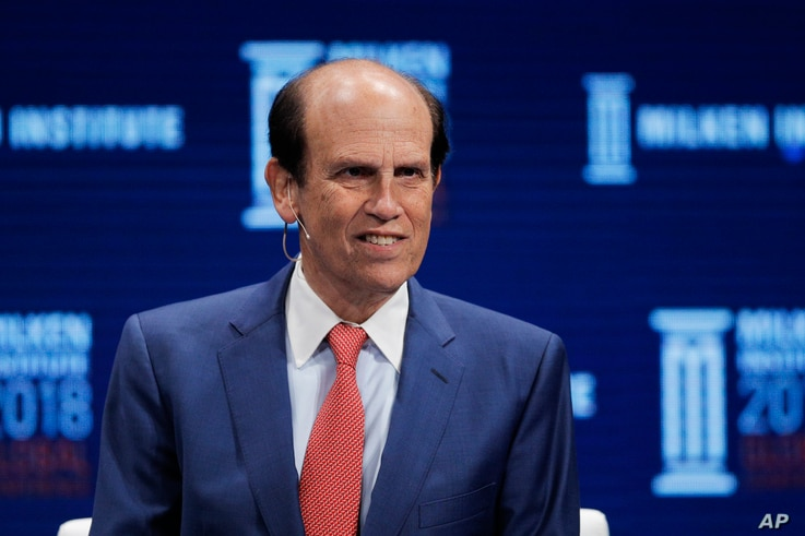 FILE - In this April 30, 2018, file photo,  financier Michael Milken leads a discussion at the Milken Institute Global…