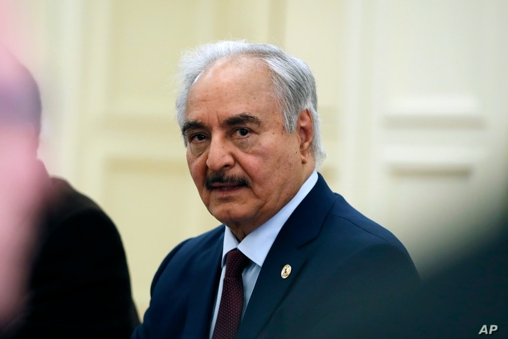 Libyan Gen. Khalifa Hifter joins a meeting with the Greek Foreign Minister Nikos Dendias and other officials in Athens, Friday,…