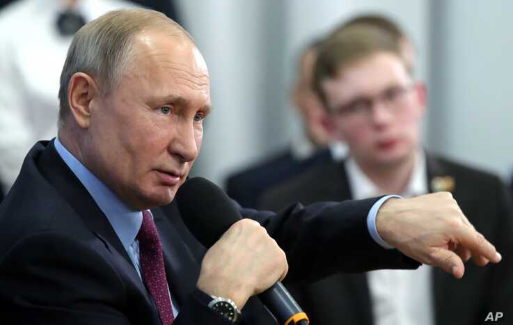 Russian President Vladimir Putin speaks during a meeting with students and researchers of an industrial college in Cherepovets,…