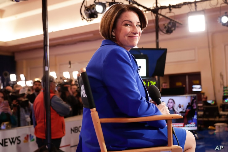 Democratic presidential candidate, Sen. Amy Klobuchar, D-Minn., waits to do an interview in the spin room after a Democratic…