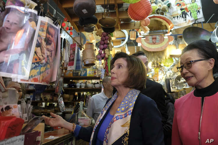 Speaker of the House Nancy Pelosi, D-Calif., looks over items at The Wok Shop during a tour of Chinatown Monday, Feb. 24, 2020,…