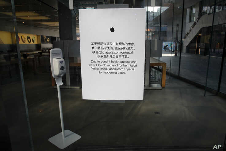 In this photo taken on Monday, Feb. 10, 2020, a closed notice is seen on an Apple store at the capital city's popular shopping…