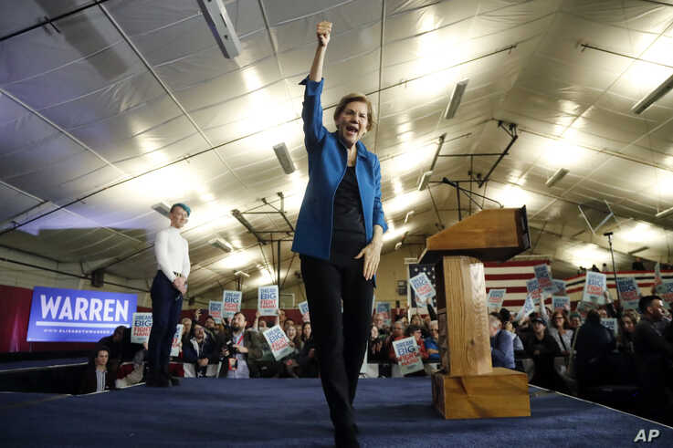 Democratic presidential candidate Sen. Elizabeth Warren, D-Mass., aknowledges supporters at a primary election night rally,…