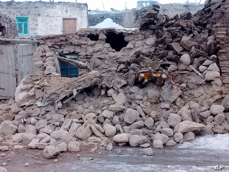 Houses are reduced to rubble after an earthquake hit villages in Baskale in Van province, Turkey, at the border with Iran,…