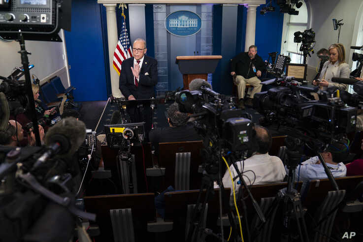 White House chief economic adviser Larry Kudlow talks with reporters about the impact of the Coronavirus on markets in the…