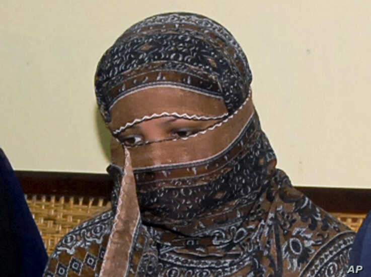 FILE - In this Nov. 20, 2010, file photo, Asia Bibi, a Pakistani Christian woman, listens to officials at a prison in…