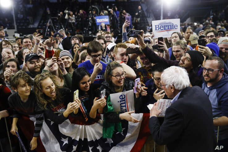 Democratic presidential candidate Sen. Bernie Sanders, I-Vt., meets with attendees campaign event, Thursday, Feb. 27, 2020, in…