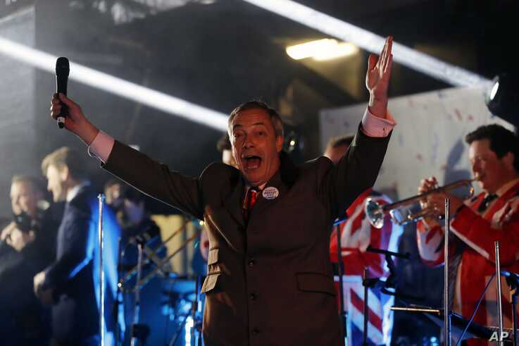 Brexit Party leader Nigel Farage celebrates during a rally in London, Friday, Jan. 31, 2020. The U.K. officially departs the EU…