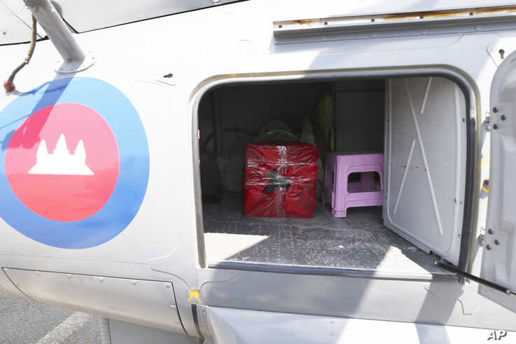 A box containing swab samples from cruise ship passengers sits in a helicopter before being transported to phnom Penh for…
