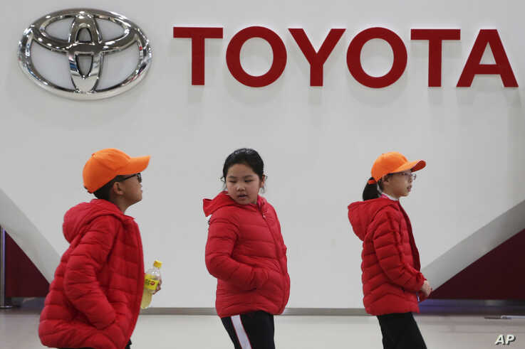 In this Jan. 15, 2020, photo, visitors walk at Toyota gallery in Tokyo. Japanese automaker Toyota Motor Corp. said Friday, Feb…