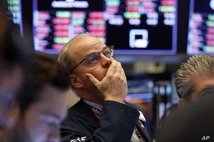 Trader David O'Day works on the floor of the New York Stock Exchange, Friday, Feb. 28, 2020. Stocks are opening sharply lower…