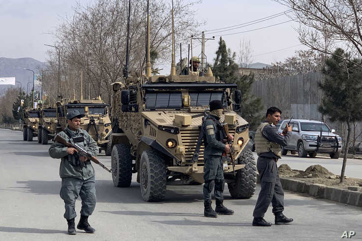 Foreign security personnel and Afghan police arrive at the site of an attack in Kabul, Afghanistan, Friday, March 6, 2020…