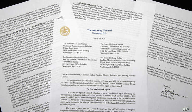FILE - In this March 24, 2019, file photo, a copy of a letter from Attorney General William Barr advising Congress of the…