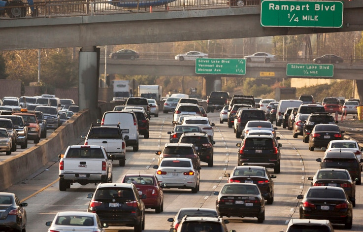 FILE - This Dec. 12, 2018, file photo shows traffic on the Hollywood Freeway in Los Angeles. President Donald Trump's is…