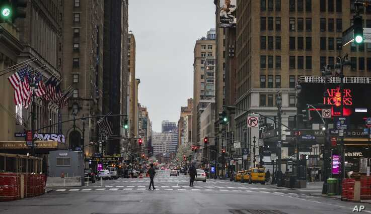 A usually busy 7th Avenue is mostly empty of vehicles, the result of citywide restrictions calling for people to stay indoors…