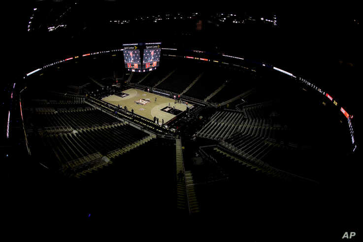 Big 12 commissioner Bob Bowlsby is seen on the big screen in an empty Sprint Center as he talks to the media after canceling…